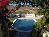 Foto einer Terrasse mit Swimmingpool
